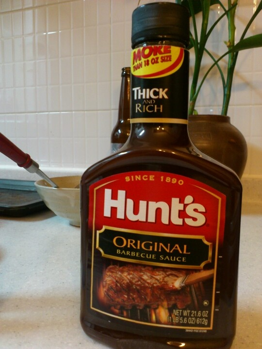 Hunt's original barbeque sauce it smells like that I am in the Bennigans's =-)