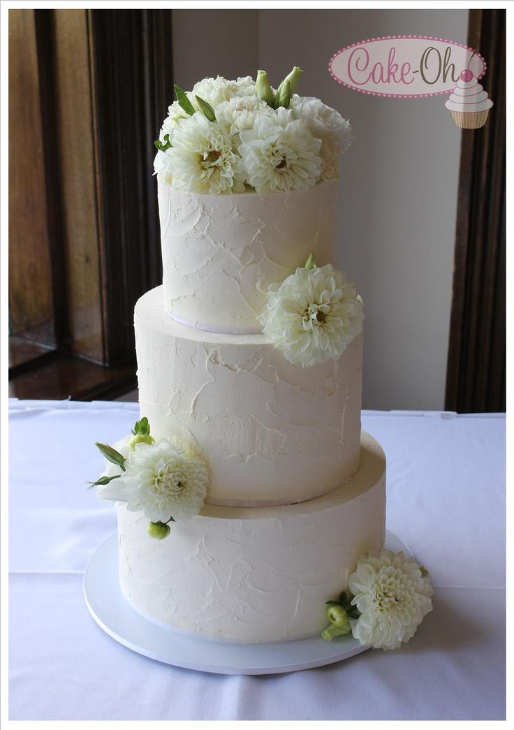 Rustic Buttercream Three Tier Wedding Cake with fresh flowers.