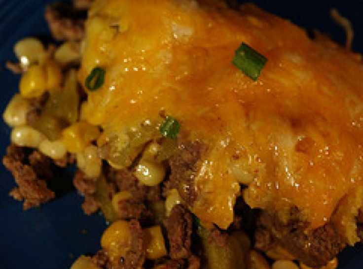 MEXICAN CORNBREAD CASSEROLE  2 bx  cornbread mix   1 lb  ground beef   1 sm  can chopped greeen chilies   1 pkg  taco seasoning mix   1 can(s)  regular corn   1 can(s)  creamed corn   1 1/2 c  cheddar cheese, shredded
