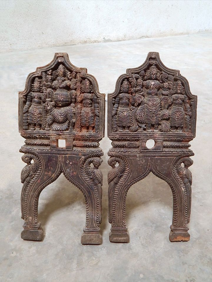 A pair of wooden Kavadi arches, with Lord Ganesha and Lord Subramanya respectively as the central figures. The Kavadi's are made in the folk or tribal style of rural Tamil Nadu.
