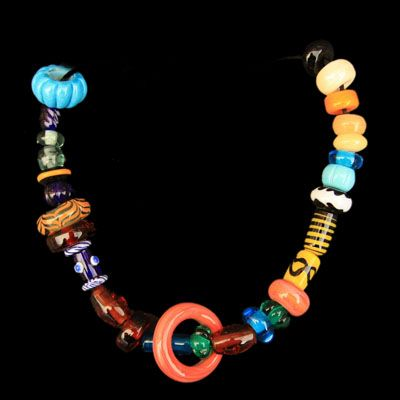 Viking Necklace from the Isle of Man  A replica of a Viking necklace found in a female pagan Viking grave on the Isle of Man.    Each bead is a copy of the original Viking glass bead, entirely handmade in England.  £114 from the Jelling Dragon.
