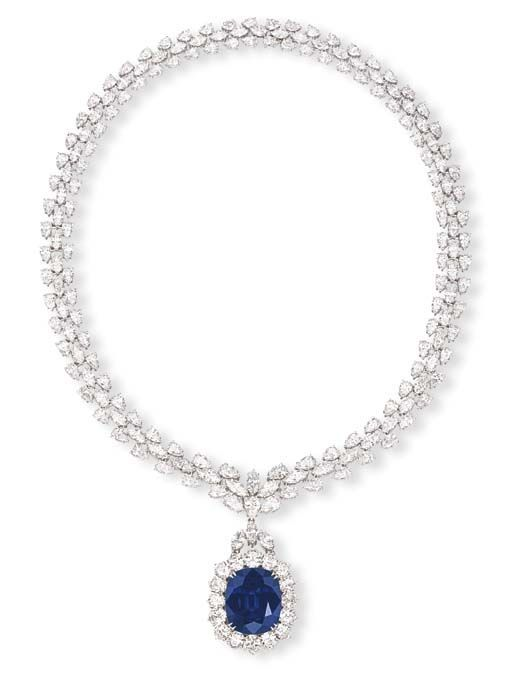 A SAPPHIRE AND DIAMOND PENDANT NECKLACE  Set with a detachable cushion-shaped sapphire weighing 39.13 carats, suspended from the pear and marquise-cut diamond three-row necklace, mounted in platinum, 45.0 cm long