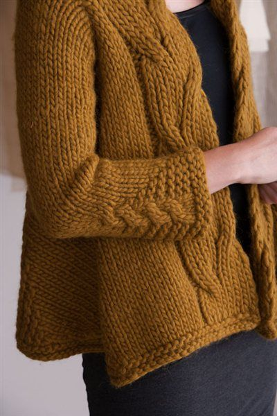 """Go There Now Mirrored-Cable Swing CoatAMY GUNDERSON A super bulky yarn makes a cabled sideways jacket easy to knit up. Fronts are curved with short rows and accented with a large cable for a swingy silhouette. FINISHED SIZE 151⁄4 (163⁄4, 18, 203⁄4, 22)"""" back width, from center of underarm to center of underarm. Jacket shown …"""