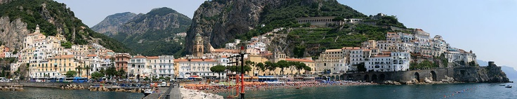 I Must visit this place one day... Panoramic view of the town of Amalfi seen from the pier with the Amalfi Cathedral in the center.