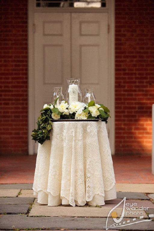Unity candle table for ceremony with flower arrangement... could be reused for decoration at reception on either guest table, cake table or sweetheart table.