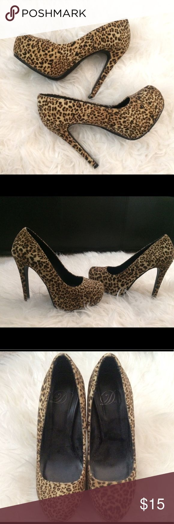 Leopard Print Pumps Gently used animal print heels. Velvet finish. Soles/heel are in great condition since they were barely used. Fits true to size and very comfortable. Shoes Heels