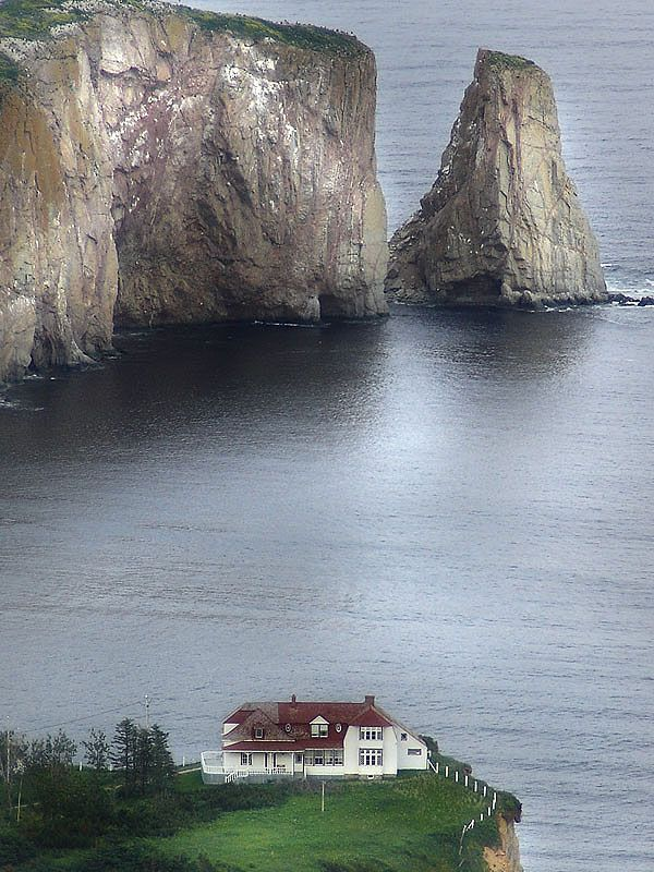 This house sits on a rock just in front of the Rocher Perce in Quebec. photo by jean francois therreault. Also not far from Forillon National Park. Camping, trails and whale watching. Nice area and not over developed.