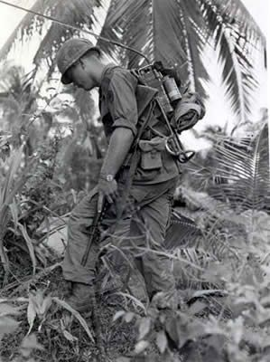 Military police radio telephone operator in the field, 1967.