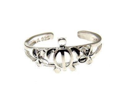 "Brand new solid sterling silver (not plated, not bonded) Hawaiian honu turtle and plumeria flowers toe ring - The honu measures 1/4"" wide and 5/16"" long. - Each Plumeria flower measures 4mm. - Each to"