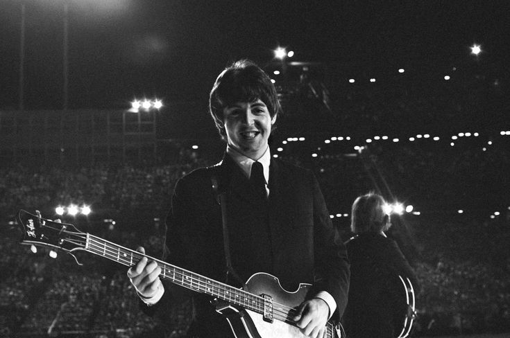 Paul McCartney, turns away from the audience and seeing Bob Bonis on the side of the stage with his camera, gives him a big and beautiful smile. Metropolitan Stadium, Bloomington, Minnesota on August 21, 1965  http://www.huffingtonpost.com/2012/11/08/lost-beatles-photographs-_n_2093677.html#slide=1737850