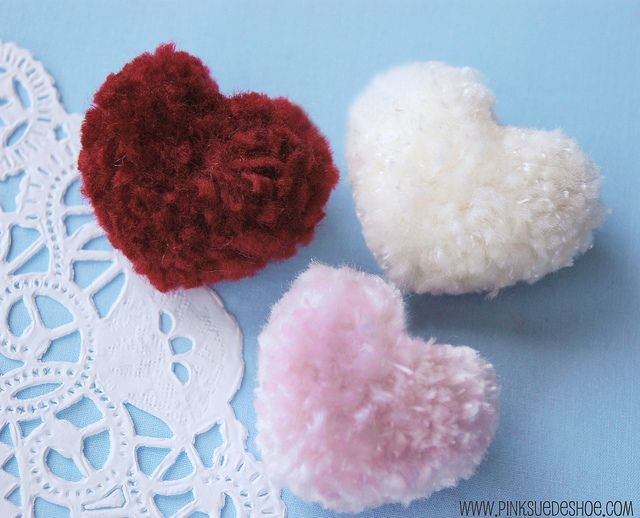 Heart pom poms. Made in the same way as normal pom poms but with heart shaped cardboard bases??