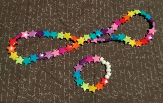 Check out this item in my Etsy shop https://www.etsy.com/listing/263321433/kandi-rainbow-star-necklace-bracelet