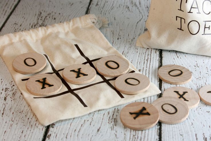 """This tic-tac-toe game makes a great gift. This item comes with 5 wooden""""X's"""" and 5 wooden """"O's"""". It also comes with a small drawstring bag with the tic tac toe board on one side. When not in use, the"""