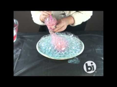 How to Create the Bubble Technique: mix hand soap, water and underglaze in cup. use straw to blow bubbles in cup and allow to overflow onto work. layer several colors, pop bubbles as needed. once applied, turn work over onto plastic coated surface and detail bottom of work as needed. flip work over and dab surface to remove any leftover bubbles