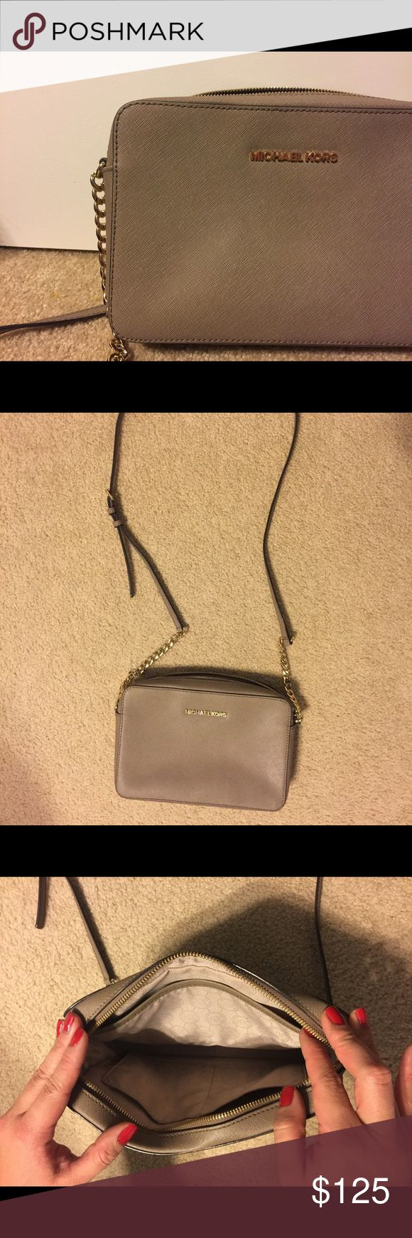 Michael Kors Jet Set large crossbody This is a gently used Michael Kors jet set large crossbody bag. The color is taupe. From my experience it has gone perfectly with every outfit for every occasion. There are no flaws with the bag except for a slight discoloration of the H on the front of the bag. The discoloration is not noticeable when wearing. A picture is posted with the discoloration seen. Hope you love it! Michael Kors Bags Crossbody Bags