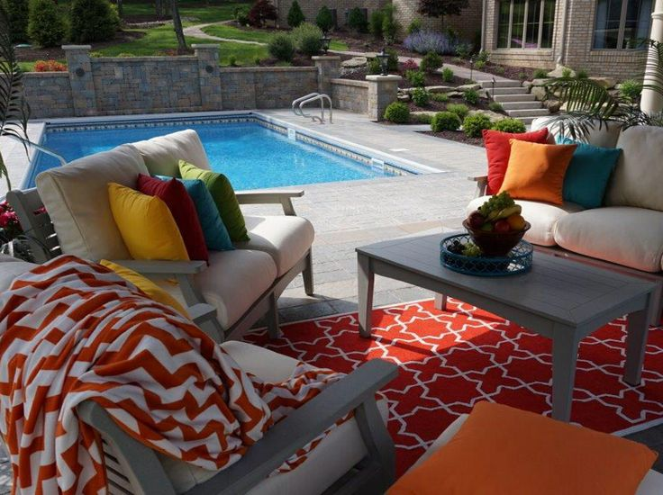Our Classic Terrace Deep Seating Furniture With Bright Pillows And Rug  Creates A Tropical Feel To This Poolside Relaxation Spot. The Furniture Is  Protected ...