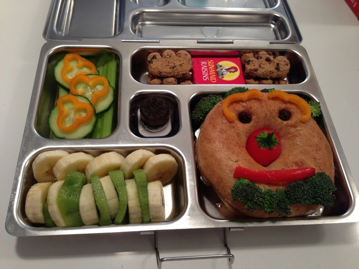 PlanetBox Face Bagel with Cream Cheese, Banana/Kiwi, Cucumber/Celery/Mini Peppers, Bear Paws, Raisins