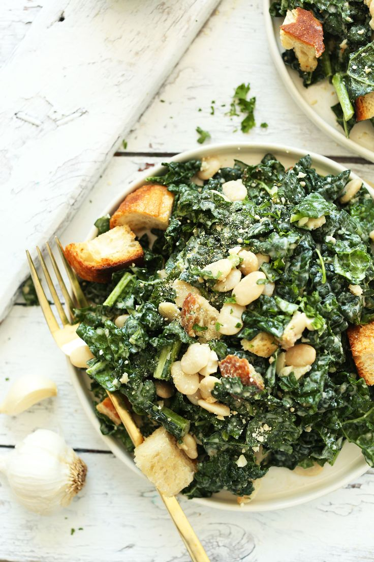 30-minute AMAZING Lemony Garlic Kale Salad with Butter Beans and Garlic Croutons. The Garlic-Tahini Dressing makes it! #vegan #salad #recipe #kale #healthy