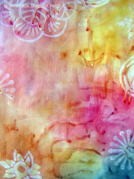 Mist a stamp with water and stamp directly onto a watercolored background. The stamp picks up the color and leaves a pretty white mark. Would love to try this idea myself and with the kids!