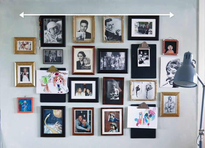 This photo display wall was created by firstly lining up all the frames at the top. The arrow at the top of the image can be used as guidance.