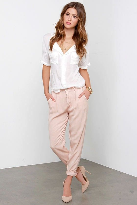 Pink trousers and white short sleeved blouse