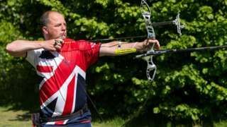 Image copyright                  Archery GB Image caption                                      Dave Phillips now trains in Cwmbran with the same archery club he belonged to as a teenager                                Four years ago he was watching the Olympics from his couch. Diagnosed with multiple sclerosis, Dave Phillips, 50, from Cwmbran, south Wales, had been signed off work sick. He was given early retirement from Tata Steel later that