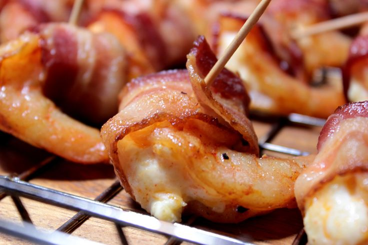My smoked shrimp, butterflied, stuffed with cream cheese, wrapped in bacon then smoked to perfection is to die for and in this instructional, I show you exactly how to do it yourself.