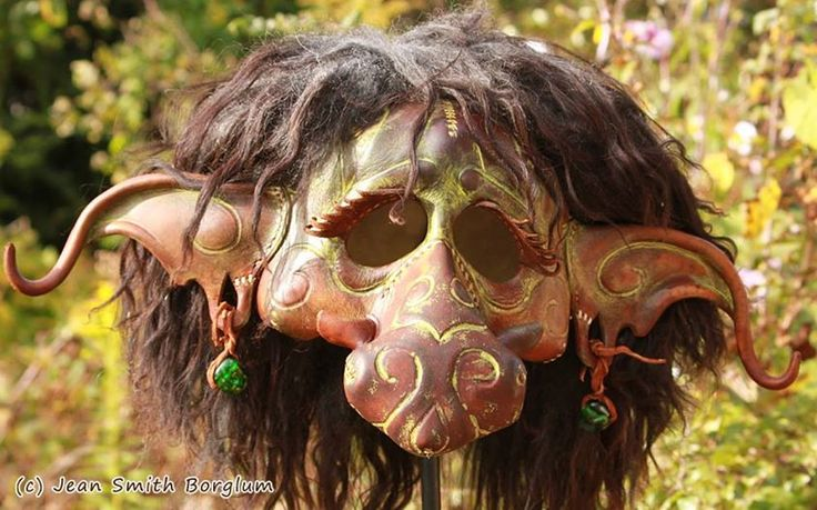 Trude the She Troll - The troll mask is 100 % hand-made and hand-shaped of vegetable tanned leather. The other materials are grain color, acrylic paint, cow teeth, butyric acid tanned sheepskin and earrings of glass and cowhide.