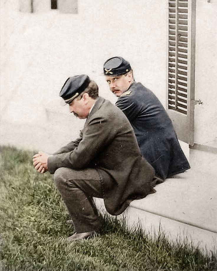 Candid photograph of General of the Army, Philip Sheridan, and his friend Major General James Forsyth, sitting on a back porch