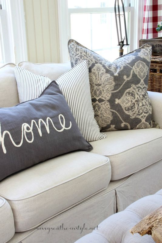 Combine different colors and patterns in your pillows like these ones from Savvy Southern Style |  Friday Favorites at www.andersonandgrant.com