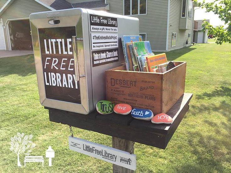 "A mini-cooler turned into a Little Free Library book exchange! Talk about an easy, creative way to start a Library. The steward is Kimberly Waltman in Little Falls, MN. Here's her story:  ""We replaced it with this used, repurposed mini cooler. We're making up for its small size by supplementing with a crate of children's books during dry weather. And, new to our LFL - Kindness Rocks! Swing by, grab a book, grab a rock, and enjoy. Thanks for visiting!"""