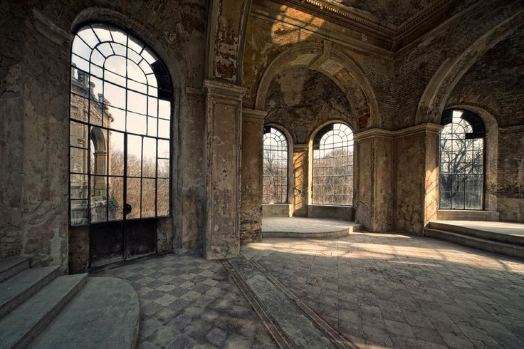 Abandoned room with large windows.