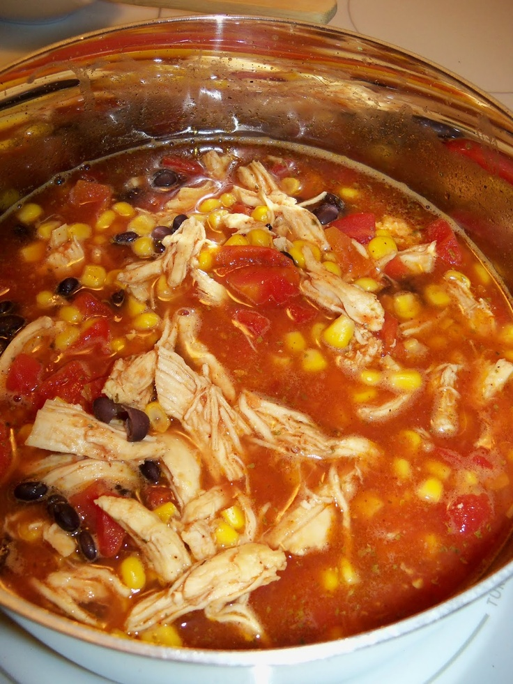 Chicken Tortilla Soup. I shredded a rotisserie chicken in my mixer with the paddle. I also added pre-diced garlic and an extra can of chicken broth. I left out one can of black beans and put in chili beans for a variety