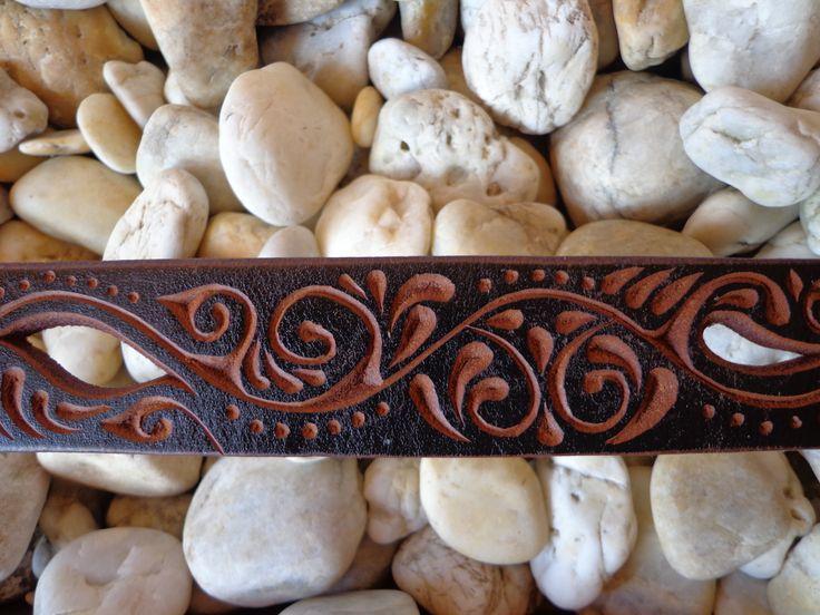 öv- carved leather belt