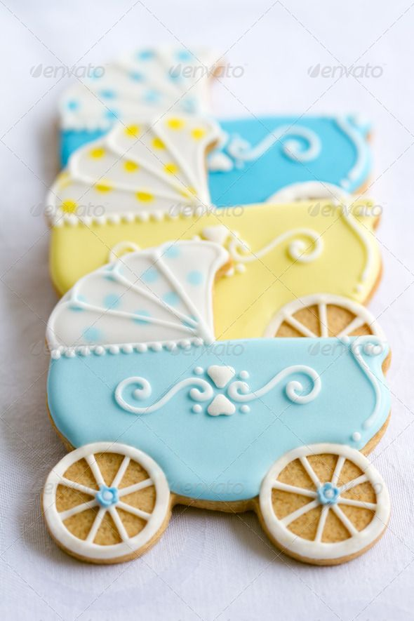 Baby shower cookies. Blue & Yellow baby stroller. Ideas for baby shower sugar cookies decoration. Stock photo.