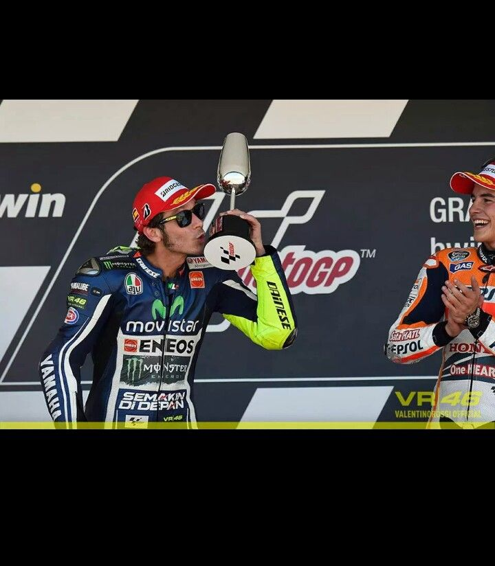 Valentino Rossi (2nd ) and Marc marquez (1st) on the podium at Jerez 2014