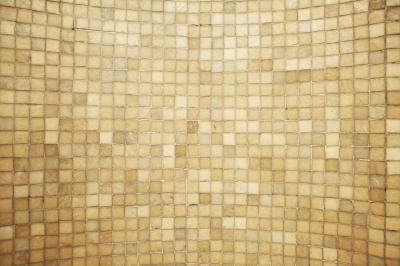 Attractive, washable tile creates a durable wall surface when installed over drywall, making it a long-term design element in most cases. If the tiles were installed correctly, removing them often ...