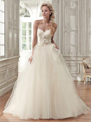 Elegant glamour is found in this stunning ball gown, featuring a voluminous tulle skirt, romantic sweetheart neckline, and lace bodice, accented with metallic embroidery and glittering Swarovski crystals. Finished with pearl buttons over zipper and inner corset closure.