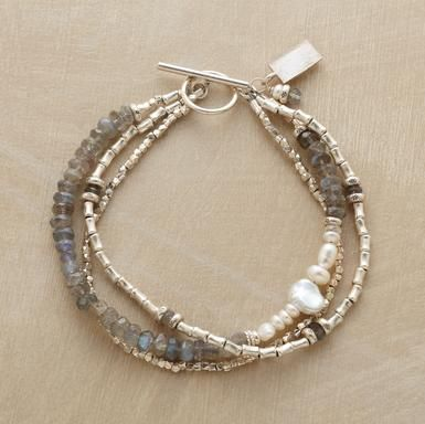 SILVER SPOOLS BRACELET--Sterling silver spools and hammered beads dominate two strands