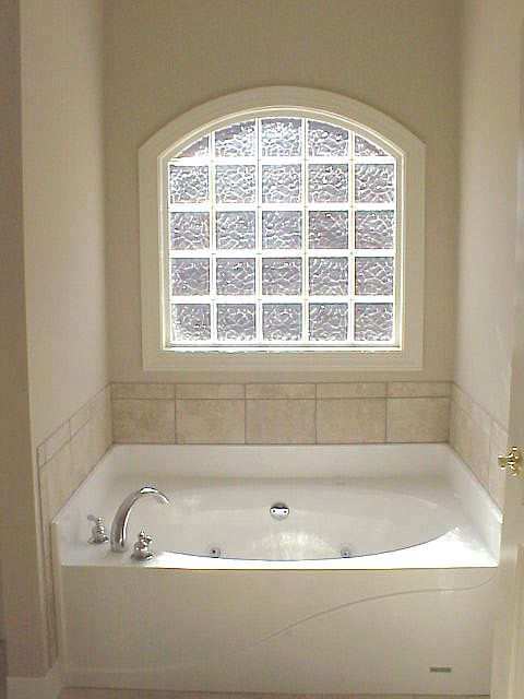 Arched glass block window to mirror arch above my shower.