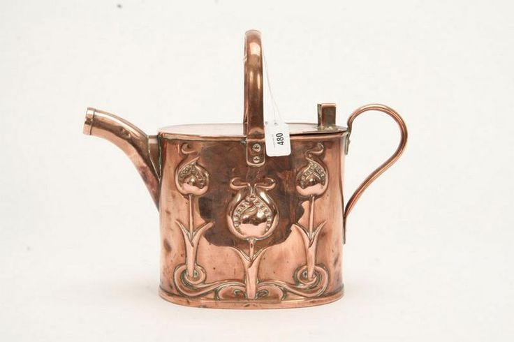An Art Nouveau period watering can in copper of oval form with… - Copper - Metalware - Carter's Price Guides to Antiques and Collectables