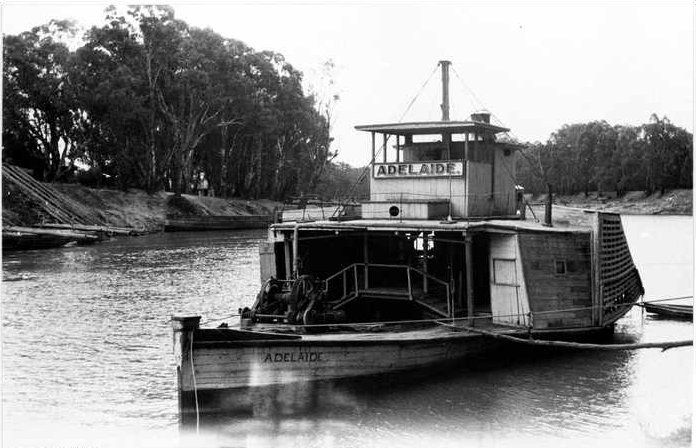 The 'Adelaide' paddle steamer above Echuca Bridge,  Murray River, Echuca, Victoria, 1937, being refitted.