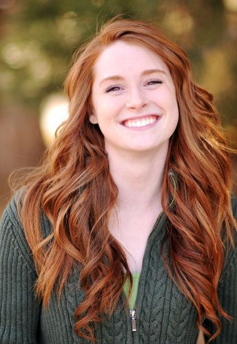 Pretty redheaded model with a great smile. She has long