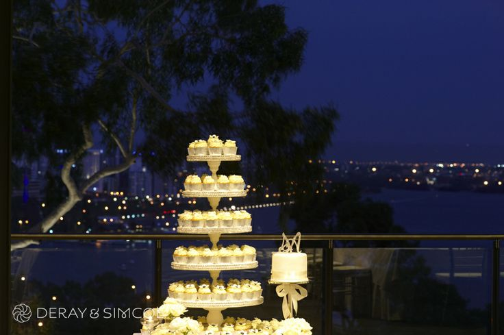 Cupcake wedding cake with the city skyline in the background. Wedding reception styling, ideas and inspiration. Wedding Reception at The State Reception Centre Kings Park, Perth Western Australia  Photography by DeRay & Simcoe
