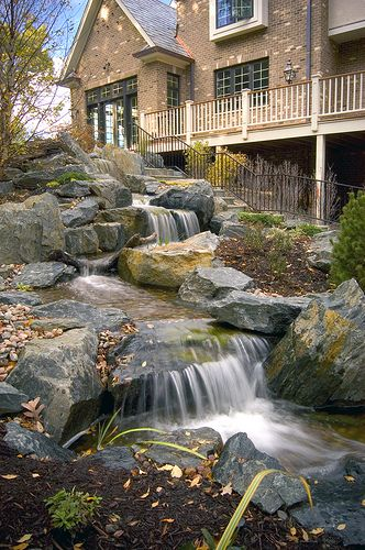 Fabulous natural looking stream!  Water Feature Waterfall by Aquascape, via Flickr