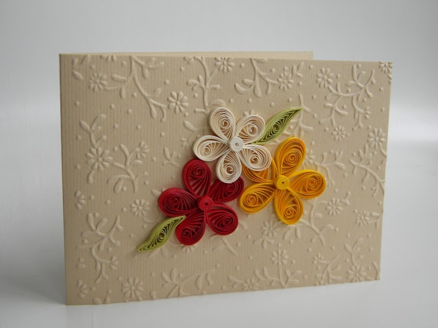 Quilling by Anca Milchis. Pretty use of embossed paper.