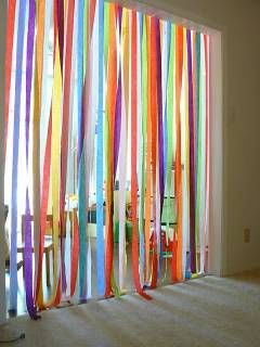 colorful, whimsical party decor - plastic streamers, maybe from cut up plastic tablecloths, attach to pool noodles and hang the noodles. #streamers #party #decorations