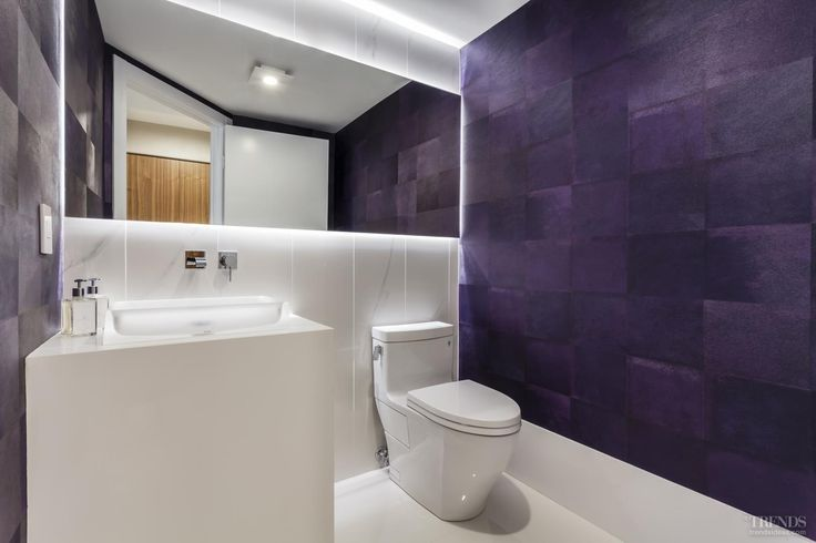 Faux cowhide wallpaper adds a vibrant colour accent to this powder room
