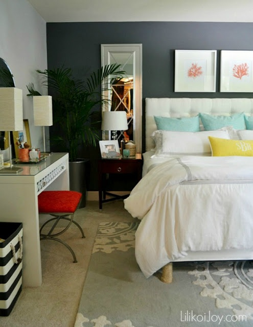 Neutral dark grey color pallete. Pops of bright colour in accessories, chair, pillows etc