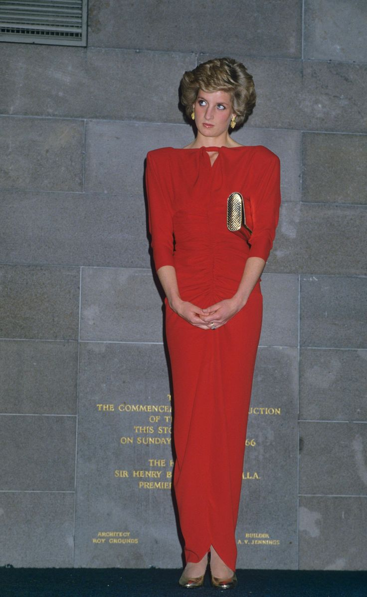 28 October 1985 Victorian tour day two: daytime visit to Portland and the royal children's hospital (sailor cap and striped coat dress) evening: state reception at the national gallery (slimline red rushed dress with thigh split)